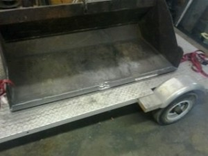 """Replaced skid plate and placed 1"""" TAC welds on the back and laid a bead entire length on front"""