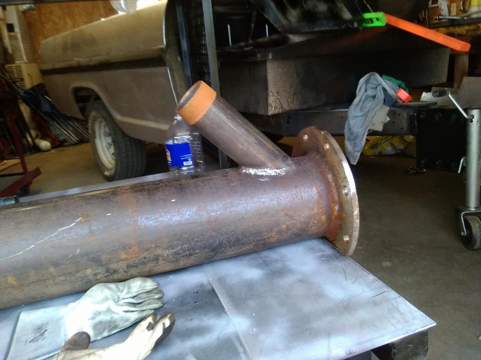 Cut a 3 inch pipe at a 45 degree angle and weld it onto a 8 inch irrigation pipe.